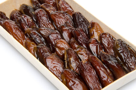 dates fruit: Dates in a wooden box, isolated on white