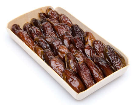 Dates in a wooden box, isolated on white