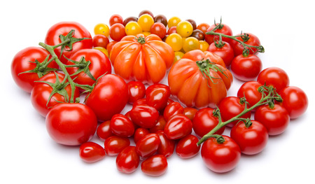 Different varieties of tomatoes, isolated on white photo