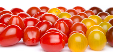 cherry varieties: Different varieties of cherry tomatoes, isolated on white Stock Photo