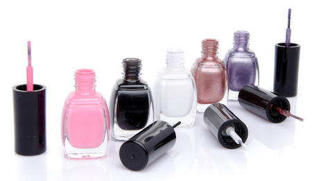 Composition with open nail polish bottles, isolated on white, isolated on white photo