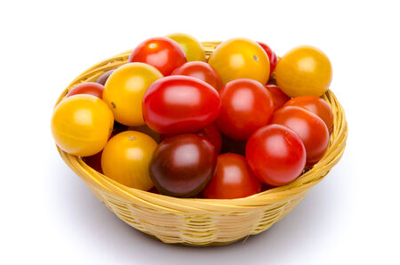 cherry varieties: Different varieties of cherry tomatoes in a basket, isolated on white Stock Photo