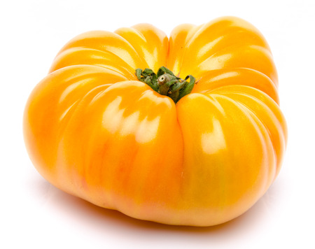 Yellow beefsteak tomato, isolated on white