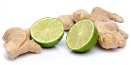Ginger with a lime cut in half, isolated on white