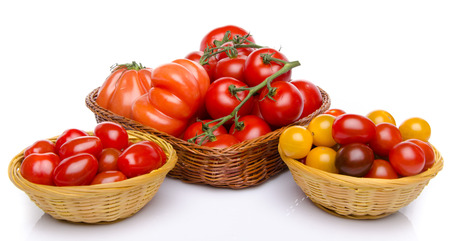 Composition of different varieties of tomatoes, isolated on white photo