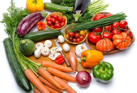 Composition with different fresh vegetables, isolated on white photo