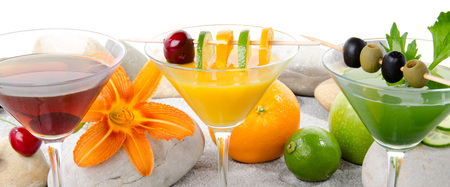 Composition with a orange, cherry and green vegetables cocktails photo