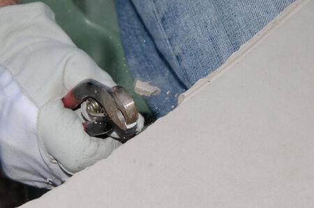 nipper: Craftsman using a tile nipper to cut a tile Stock Photo