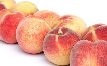 aligned: Ripe peaches aligned diagonally, isolated on white Stock Photo