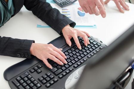 workteam: Workteam in office working on a computer