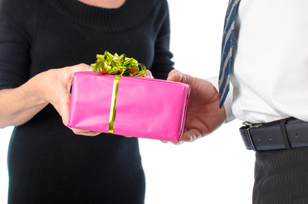 Man giving a present to a woman, isolated on white photo
