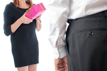 Woman giving a present to a man photo