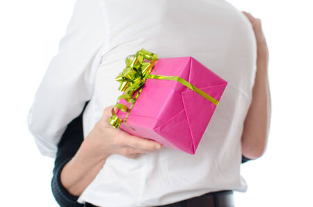 Couple hugging, woman holding a gift, isolated on white photo
