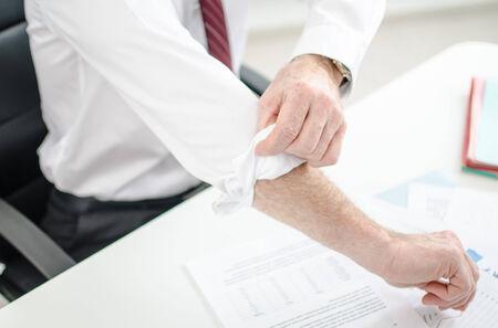 Motivated businessman rolling up his sleeves Standard-Bild