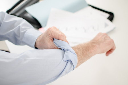 Motivated businessman rolling up his sleeves photo
