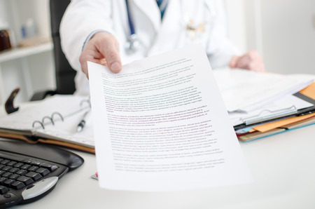 medical notes: Doctor showing medical notes in his office