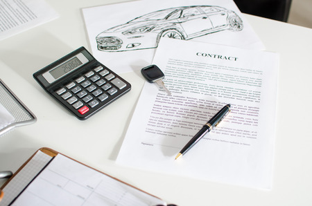 auto leasing: Sales contract, key, pen and calculator on a desk Stock Photo