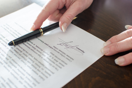 paperwork: Contract signed, closeup