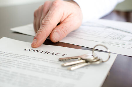 realtor: Realtor showing a contract with his finger