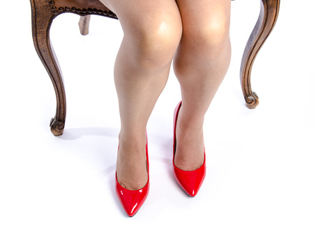 Woman wearing red high heel shoes, isolated on white photo