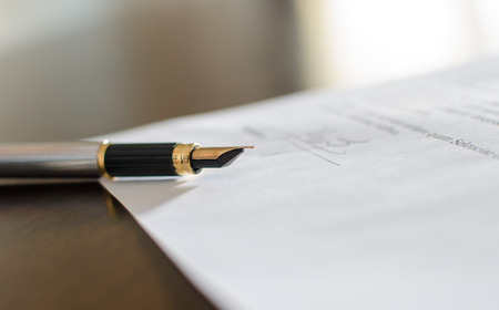 signed: Pen on a signed contract, closeup Stock Photo