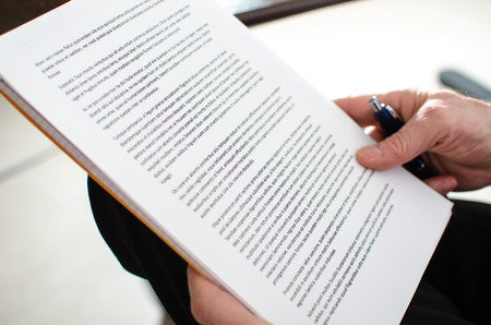 Reading documents, closeup Archivio Fotografico