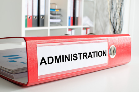 administration: Administration wording on the back of a red binder