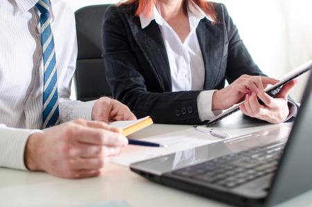 explaining: Business people showing and explaining data Stock Photo