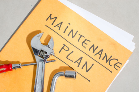 Different tools on a folder of maintenance plan Stok Fotoğraf - 37736098