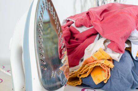 laundry pile: Pile of laundry on ironing board before ironing