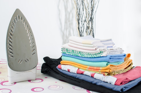 steam iron: Iron and ironed linen on a ironing board