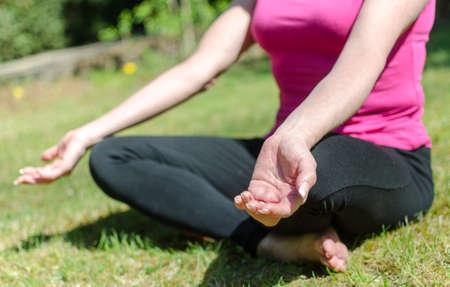 doing: Woman doing yoga outdoors