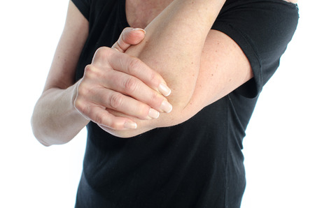 human's elbow: Woman holding her painful elbow