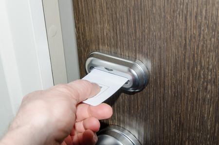 keycard: Hand inserting keycard in hotel
