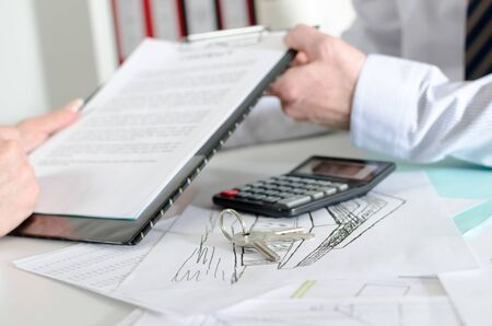 real estate contract: showing a real estate contract to his client Stock Photo