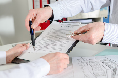 agency agreement: showing where to sign the real estate contract before delivering the keys Stock Photo