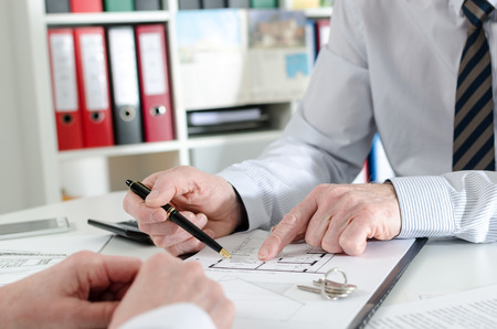 explanations: giving explanations to his client at the estate agency