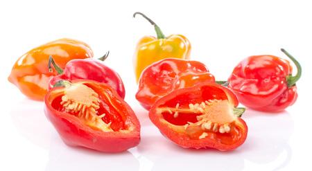 habanero: Fresh whole and half habanero peppers, isolated on white
