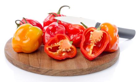 habanero: Fresh habanero peppers on cutting board, isolated on white Stock Photo