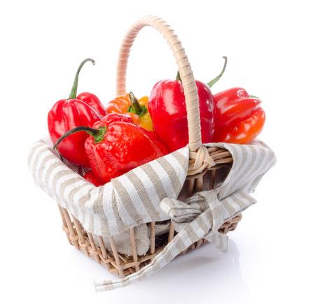 habanero: Fresh habanero peppers in a basket, isolated on white