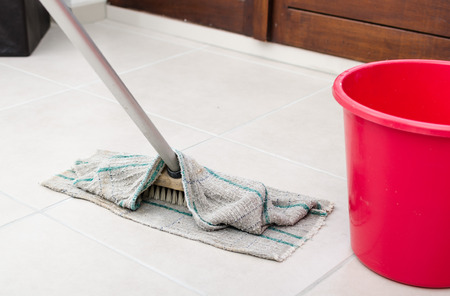 tiled floor: Cleaning of tiled floor with floorcloth