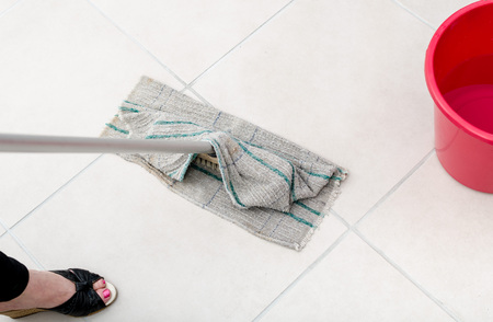 Cleaning of tiled floor with floorcloth