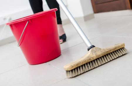 tiled floor: Cleaning of tiled floor with broom brush
