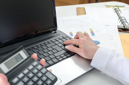 account executive: Accountant woman working on financial results at the office Stock Photo