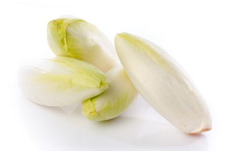 Fresh chicory, isolated on white Foto de archivo
