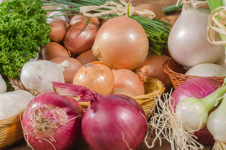 Background of different types of onions, garlic and shallots