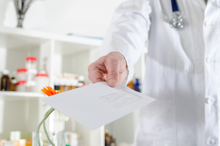 Doctor showing a letter in medical office
