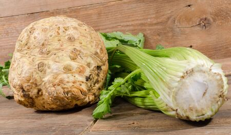 celery root: Celery root and green celery on wooden background