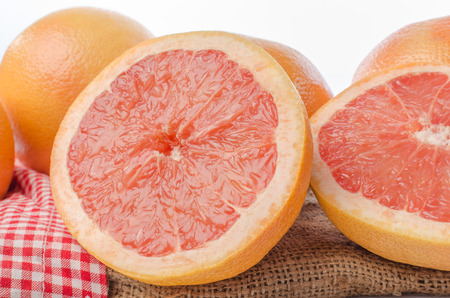 grapefruits: Fresh grapefruits on burlap Stock Photo