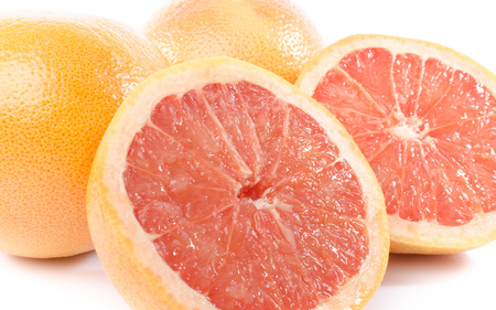 grapefruits: Fresh grapefruits, isolated on white